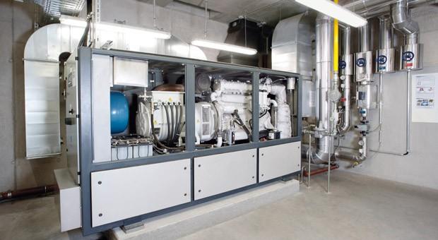 Ein Blockheizkraftwerk von Viessmann: Mit Anlagen wie diesen können Unternehmen selbst Strom erzeugen.