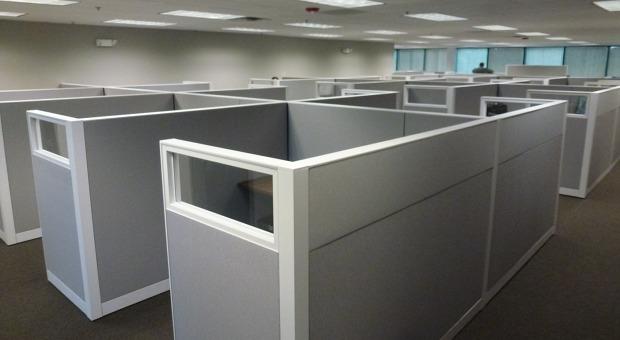 Einblick in das Großraumbüro von Integrated Project Management: Typische amerikanische Cubicle-Arbeitszellen, die nicht erahnen lassen, welche Philosophie im Unternehmen steckt.
