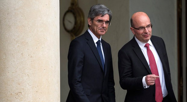 Siemens-Chef Joe Kaeser und der Chef von Siemens Frankreich, Chistophe De Maistre (r.) beim Verlassen des Élysée-Palastes nach einem Gespräch mit dem französischen Präsidenten François Hollande.